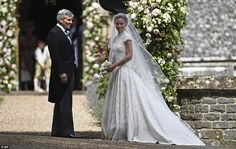 Kate's sister Pippa's and her father before entering the church for her wedding to James Matthews. Pippa wore a gown by British designer Giles Deacon. 5/20.17.