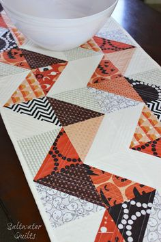 Reversible holiday table runner. You don't have to put it away after Halloween. Would be fun for Christmas, too.