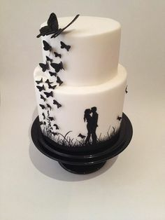Foto: Black and White hand painted Silhouette cake with cascading butterflies.