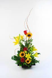 Imagini pentru flowers arrangements lily and sun flower