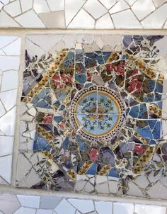 This tile is another tile found in Parc Güell lining the wall. This colorful tile is more unique in that you can tell it was once one piece that was smashed for affect.