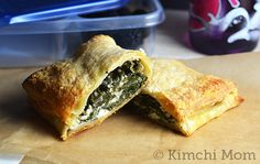 Greek-style Spinach Hand Pies | Just made these, but with olive oil crust instead of puff pastry, and Josh & I just ate, like, half of them while standing over the oven. So... yeah, they're a winner.
