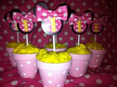 1st Birthday Minnie Mouse centerpieces. Check out my page Glorious Creations on Facebook! https://www.facebook.com/pages/Glorious-Creations/261664800514664?ref=hl