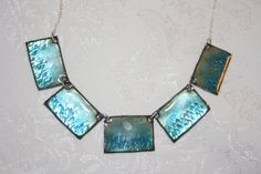 Teal mediterranean enameled necklace reflects light by KineticArts