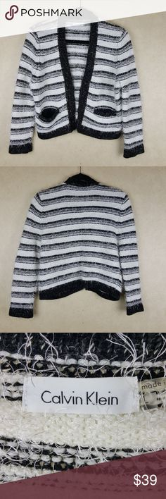 """Calvin Klein Black & White Fuzzy Cropped Sweater In excellent condition! This sweater is very soft and does offer a good amount of stretch even though it is a thicker type knitting - also has two functional small pockets on the front as well. While lying flat, the pit to end of sleeve measures 14"""" and from the top of the back neckline to the bottom of the sweater measures about 20 1/4"""".   Style/Tag Info: CDSZ9510 