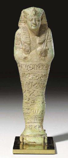 AN EGYPTIAN FAIENCE ROYAL SHABTI FOR APRIES LATE PERIOD, DYNASTY XXVI, REIGN OF APRIES, 589-570 B.C.