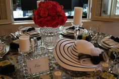 Pretty tablescape. I like the black and white hat contrasted with the red roses.