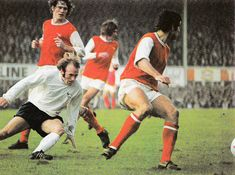 October Derby County midfielder Archie Gemmill losing his balance against Arsenal duo Pat Rice and Frank McLintock.I was at this game Autumn Archie Gemmill, Derby County, Golden Age, Arsenal, Grass, October, Rice, Football, Autumn