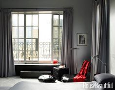 A sleek and sexy gray bedroom. Designed by David Mann. housebeautiful.com #floor_length_curtains #balcony #modern #contemporary