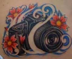 Camera tattoo by asimp, via Flickr (love the camera just not the other art work for mine)