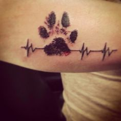 Vet Tech tattoo. This is my own dog Dixie's ink paw print with the heart beat for my 13 years working in the veterinary field.