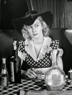vintage everyday: A Day in the Life of a Working Girl in 1940  In Giono's little speakeasy in the West Forties, Kitty Foyle sits between a bottle of Scotch and a decanter of water, turning a little glass stirring rod around in her hand. Wyn is lost to her forever, engaged to marry the kind of Main Line girl she always knew he was destined to marry. In the novel, Kitty goes on to success but finds no one to fill Wyn's place in her heart.