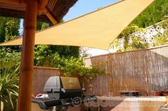 Shade for your barbecue and outside dining area.    3.6m Triangle Shade Sails, colour Desert Sand