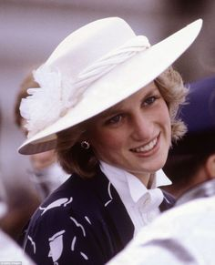 John Boyd was Diana Princess of Wales' favourite milliner, and here she is pictured wearing one of his designs as she met firemen during a visit to Manukau, New Zealand, during a royal tour to the country in April, 1983: