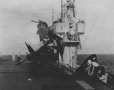 Fighter Chance Vought F4U-1A Corsair from the VBF-94, crashed into the superstructure of the American escort carrier 'Prince William' (USS Prince William, CVHE-31).