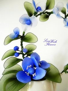 This charming blue flowers made by handcraft chenille nylon fabric flower and leaves. Bouquet dimensions approximate: 10.5 inches(w) x 5 inches(d) x 12.5 inches(h) flowerpot included at shipping package. Note:* As light shooting and computer monitor, maybe the color has a little