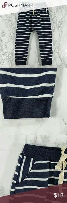 Heather navy blue strips sweatpants. Kids Adorable and comfortable Heather blue basic sweatpants. Have pockets Pull up style.  This item is brand new and never used. No tags Bottoms Sweatpants & Joggers