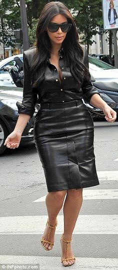 Stepping out: The reality TV star's knee-length skirt enabled her to show off the results ...