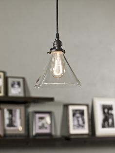 Vintage hanging pendant light fixture with glass shade, ideal for use in kitchens, restaurants and bars.