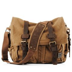 The+men+canvas+messenger+bag+with+brown+leather+trims,+buckle+straps+and+bottom+pads,+two+front+pockets+with+snap+fastenings,+metal+logo,+interior+pocket,+shoulder+strap+and+fold+over+flap.+This+durable,+functional+bag+is+ideal+for+the+demands+of+a+busy+day.  Size:H30cm×W35cm×D11cm.
