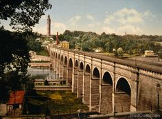 Photochrom print of the High Bridge, New York City. Just North of the Washington Bridge, photographed by the Detroit Publishing Company in 1900.