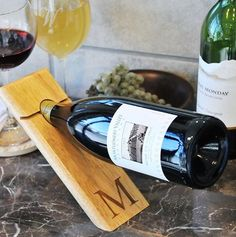 This custom-engraved Counter Balance Wine Bottle Holder uses nothing more than the science of gravity to give the illusion of a wine bottle being suspending in midair. Genius!