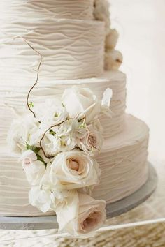 Buttercream cake with ivory roses.