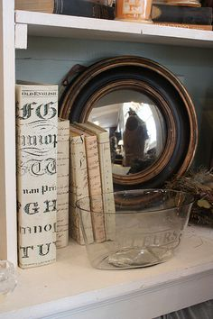 Nice to tuck a mirror into a bookshelf...especially a round one!