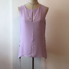 Sanctuary tank top SUPER CUTE!!! perfect for summer! Has a zipper on the back and a small slit. The sides have ties (picture). Bundles save Make an offer  No trades  Sanctuary Tops Tank Tops