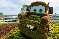 The Radiator Springs section of Flower & Garden was a nice addition this year. It would have been better if they built Carsland for Flower & Garden, but I'll settle with this for now. Topiary Garden, Garden Art, Garden Ideas, Tow Mater, Cars Characters, Jay Bird, Kids Corner, Flower Beds, Grass