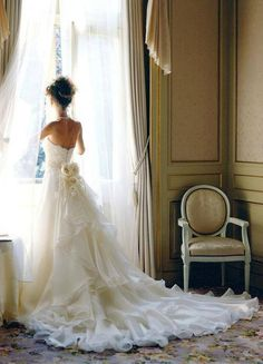 Huge, lush wedding dress train with a sweet bow sash.