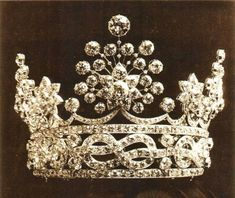 """The current Duke of Aosta is Prince Amadeo, grandson of Helene,Duchess of Aosta. Current Archduke of Autria-Este is Prince Lorenz of Belgium. His mother, HI&RH The Dowager Archduchess of Austria-Este (nee Princess Margarita di Savoy-Aosta) now owns the tiara.  The diamond tiara  was a wedding present to Princess Helene, wife of the 2nd Duke."""" Convertible, it now has a much more simple form."""