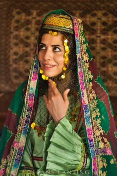 Young women posing for photograph in traditional dress, Golestan Palace, Tehran, Iran