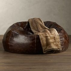 The grand leather bean bag is a beanbag made for a King. With a polished yet rustic look, the grand leather bean bag fits nicely in any household, though it's highly recommended this leather bean bag be placed in a high class man cave.]Read More. Leather Bean Bag Chair, Brown Leather Chairs, Brown Couch Living Room, My Living Room, Bean Bag Furniture, Leather Furniture, Modern Furniture, Pouf Cuir, Apartment Interior