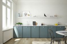 A.S.Helsingö: Quality kitchens and wardrobes with IKEA cabinets frames. INGARÖ kitchen in Petrol Blue and NOVEL aluminium handles.