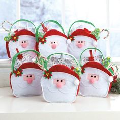 Made of thick felt, each bag has a pink pom-pom for the nose and a larger one on the end of the hat. Party Treats, Party Favors, Christmas Crafts, Xmas, Christmas Ornaments, Santa Face, Treat Bags, Large White, Gift Wrapping