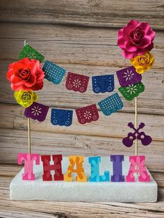 Beautiful coco inspired cake topper Measurements: inches wide by tall ( name in picture Thalia) *****please note name measurements vary between - **** If you need a specific size, please DM us with your cake size