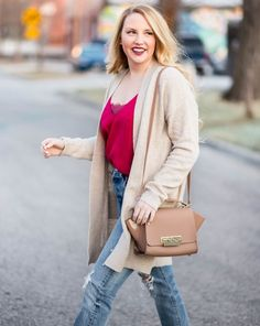 Free People lace cami layered with an oversized cardigan, paired with skinny 501 levi jeans! Spring transitioning outfits. Zac Posen Handbag! http://liketk.it/2uvN7 #liketkit @liketoknow.it