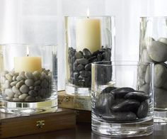 From Pottery Barn: Decorating with River Rock...take any glass container add rocks and candles for a simple look.