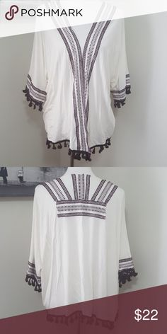 Embroidered poncho top Incredibly soft embroidered poncho top Opened front Size small to medium Tops Blouses