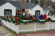 picket fence decorated with garland for christmas_wm christmas porch outdoor christmas decorations winter christmas
