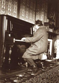 Albert Einstein playing the piano at the Nara Hotel in Japan, 1922