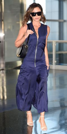 Another day, another impeccable look from Victoria Beckham. The designer ended her whirlwind NYC trip with an amazing navy jumpsuit that featured a fitted zip-up bodice, utilitarian-inspired cargo pockets, and a sweeping wide-leg silhouette. Her Victoria Beckham visor sunglasses, a structured purse, and neutral ankle-strap sandals completed her look.