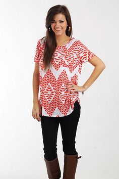 """Impressions Pocket Tee, Red $35.00 How cute is this little t-shirt? Swap out your ratty old t-shirts for this fashionable little number! It's super soft and has a little bit of a longer length and a front pocket. Plus, the pattern is so cute and right on trend!   Fits true to size. Miranda is wearing a small.   From shoulder to hem:  Small - 27""""  Medium - 28""""  Large - 29"""""""