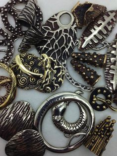 bronze toggles, pendants, cones and findings