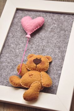 This is sweet little Teddy Bear, holding a heart shaped balloon. Its made of felt and glued on a thick felt, with 3d effect. This lovely present for a new baby you can hang on a wall or put it on a shelf. Frame measures 6.5 x 8.5 inches (17 x 22 cm) Teddy is approx 3 inches (8 cm) tall.  Little teddy is hand cutted and hand stitched, made from felt, filled with polyester stuffing.  And, yes! I SHIP WORLDWIDE!  * * * N O T E * * * This is NOT A TOY!!! Because of the little felt pieces I…