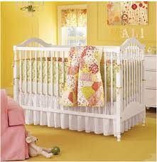Pretty much sums up what i want. very cute, yellow walls, flowr blanket, white cirb that turns into a queen bed, flower pictureframes. would add flower wall clings & flower rug though. :)