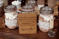 Mason Jar hot chocolate favors.  I love how they added the acrylic snowflakes.