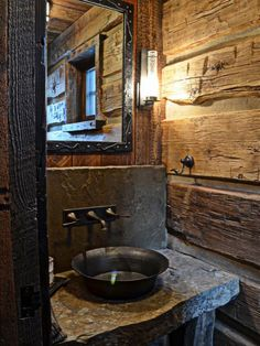"Rustic bathroom with planked walls and rough hewn stone counter ... lots of ""character"" and perfect for a cabin! #cabin #bathroom #home decor"