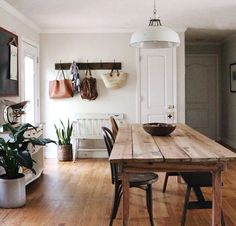 Love the bench and hooks near door, indoor plants and rustic dining table. Ideas Hogar, Lofts, Cozy House, Home Decor Inspiration, My Dream Home, Home And Living, Home Kitchens, Living Spaces, Sweet Home